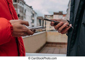 closeup of hands with mobile phone in the city