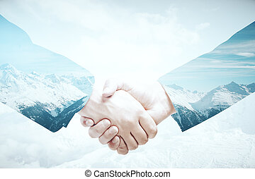 Business abroad - Closeup of handshake on abstract landscape...
