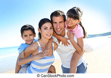 Closeup of happy family at the beach