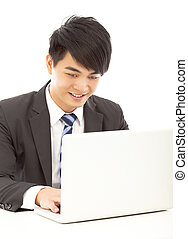 closeup of happy young business man using a laptop