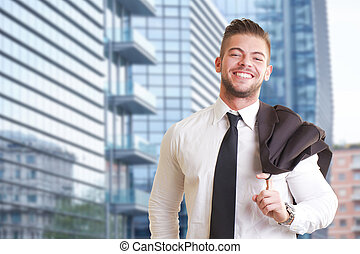Closeup Of Happy young Businessman Smiling Outdoor