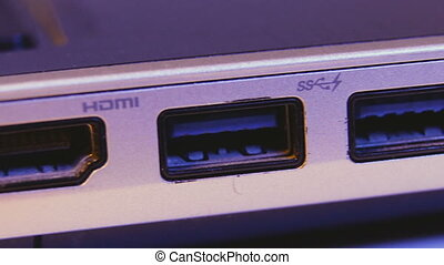 Closeup of HDMI and USB ports in a laptop.