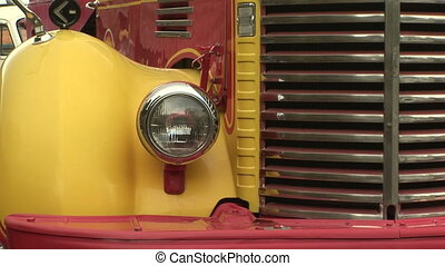 Closeup of headlight and grill of old truck - Zoom in of a...