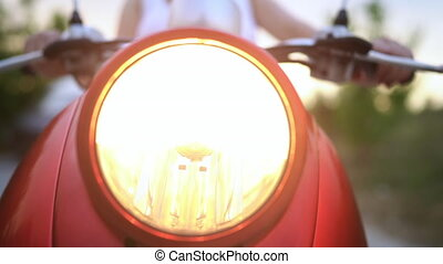 Closeup of headlight of red retro motorcycle, moped or...