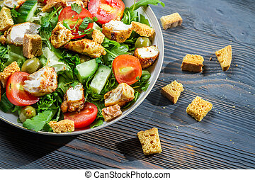 Closeup of healthy Caesar salad made of fresh vegetables