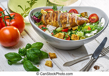 Closeup of healthy salad with chicken and ingredients