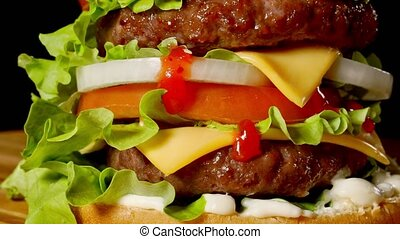 Closeup of home made beef burgers with lettuce and...