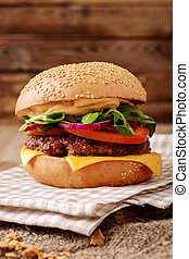 Closeup of home made burger on wooden background