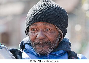 Closeup of homeless african american man. Outside during the daytime.