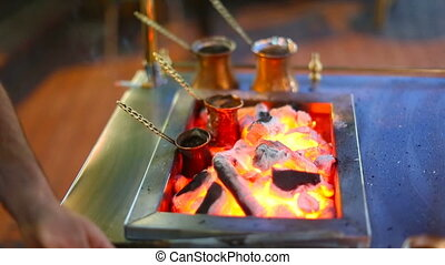 Closeup of hot coffee prepared in turk on open fire