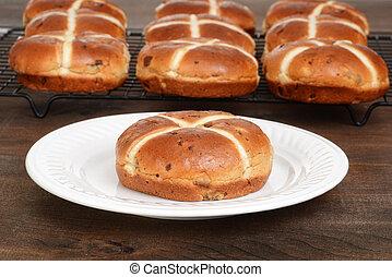 hot cross bun on a plate