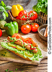 Closeup of hot dog made with fresh ingredients
