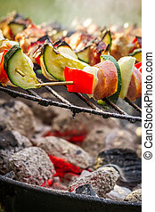 Closeup of hot skewers on the grill