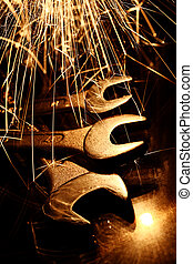 Closeup of iron spanners set and sparks