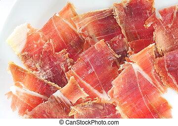 jabugo ham plate - closeup of jabugo ham plate with slices