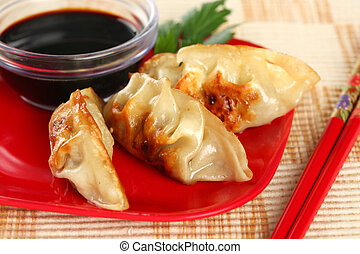 Closeup of Juicy Chinese Fried Potstickers - Closeup of...