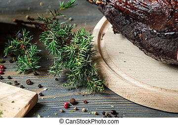 Closeup of juniper and fresh slicedsmoked ham - Closeup of...