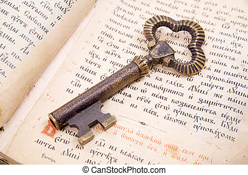 Closeup of key placed on vintage book bible - Background of...