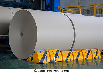 kraft paper roll in the production line - closeup of kraft ...