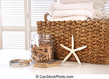 Closeup of laundry basket with fine linens on table