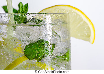 Closeup of lemon drink with ice cubes