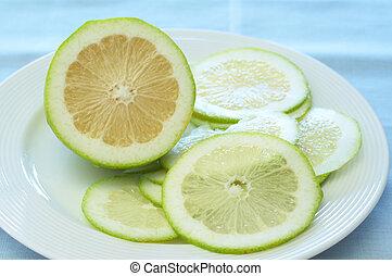 Closeup of lime lemons on a plate