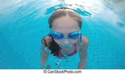 Closeup of little girl emerging from the swimming pool,...