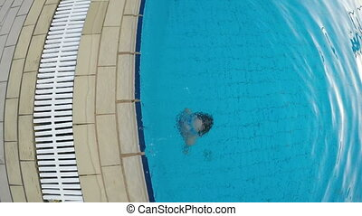 Closeup of little girl emerging from the swimming pool -...