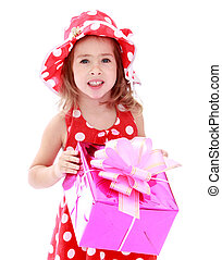 Closeup of little girl in a red polka