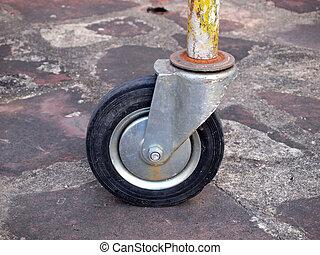 Closeup of loose wheel of industrial cart