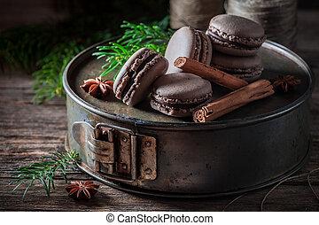 Closeup of macaroons with cinnamon and chocolate for Christmas