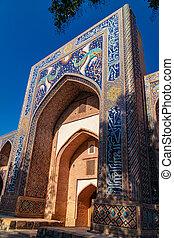 Closeup of Madrasah Nadir Divan Begi over blue sky, Bukhara,...