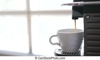 Closeup of making espresso. Preparing black coffee with coffee machine.