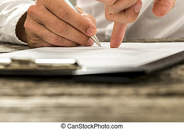 Closeup of male hand pointing where to sign a contract