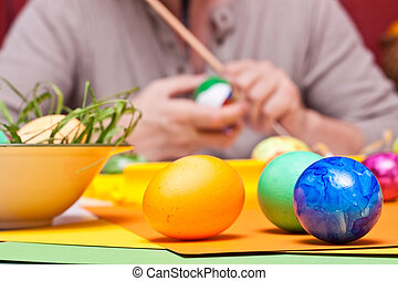 closeup of male hands and Easter eggs