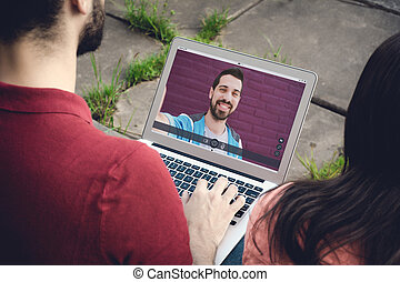 Closeup of man chatting online with her friend