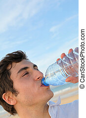 Closeup of man drinking water from bottle