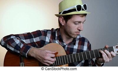 Closeup of man hands playing guitar - Closeup of hipster man...