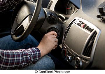 Closeup of man inserting key in car ignition lock - Closeup...