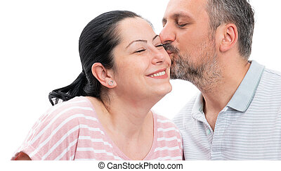 Closeup of man kissing woman cheek