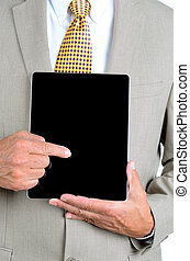 Closeup of man pointing at screen of tablet computer