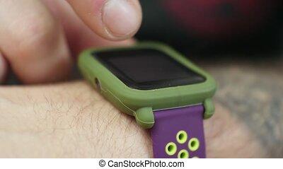 Closeup Of Man using His Smartwatch