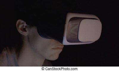 Closeup of man using virtual reality headset VR mask