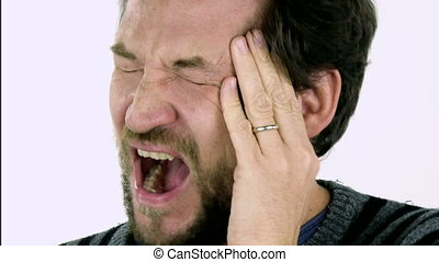 Closeup of man with headache