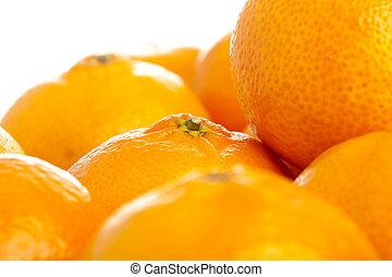 mandarin orange - closeup of mandarin orange stack on white