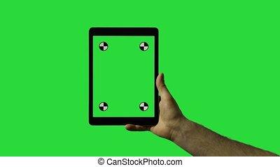 Closeup of man's hand sliding on tablet green screen