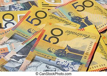 Closeup of many Australian 50 dollar notes. Shallow depth of...