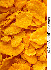 Closeup of many corn flakes breakfast morning meal as food background. Diet and healthy nutrition.
