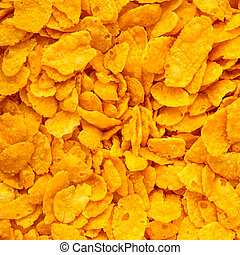 Closeup of many corn flakes breakfast morning meal as food background. Diet and healthy nutrition. Square format.