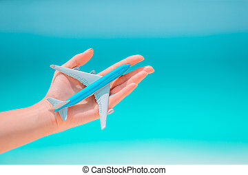 Closeup of map and model airplane background the sea